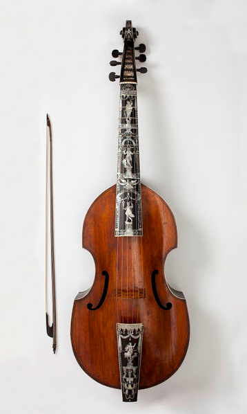 This bass viol is the only instrument known to have been made by Martin Voigt of Hamburg. Voigt may have been a pupil of Joachim Thielke, who was Hamburg's greatest luthier around 1700. This instrument is as beautifully decorated as any made by Thielke. The neck is decorated with four Greek gods and goddesses — Apollo, Venus, Mercury and Diana — inlaid in mother of pearl. In Greek myth Mercury was supposed to have invented the lyre, and Apollo excelled at playing it. The lyre was…