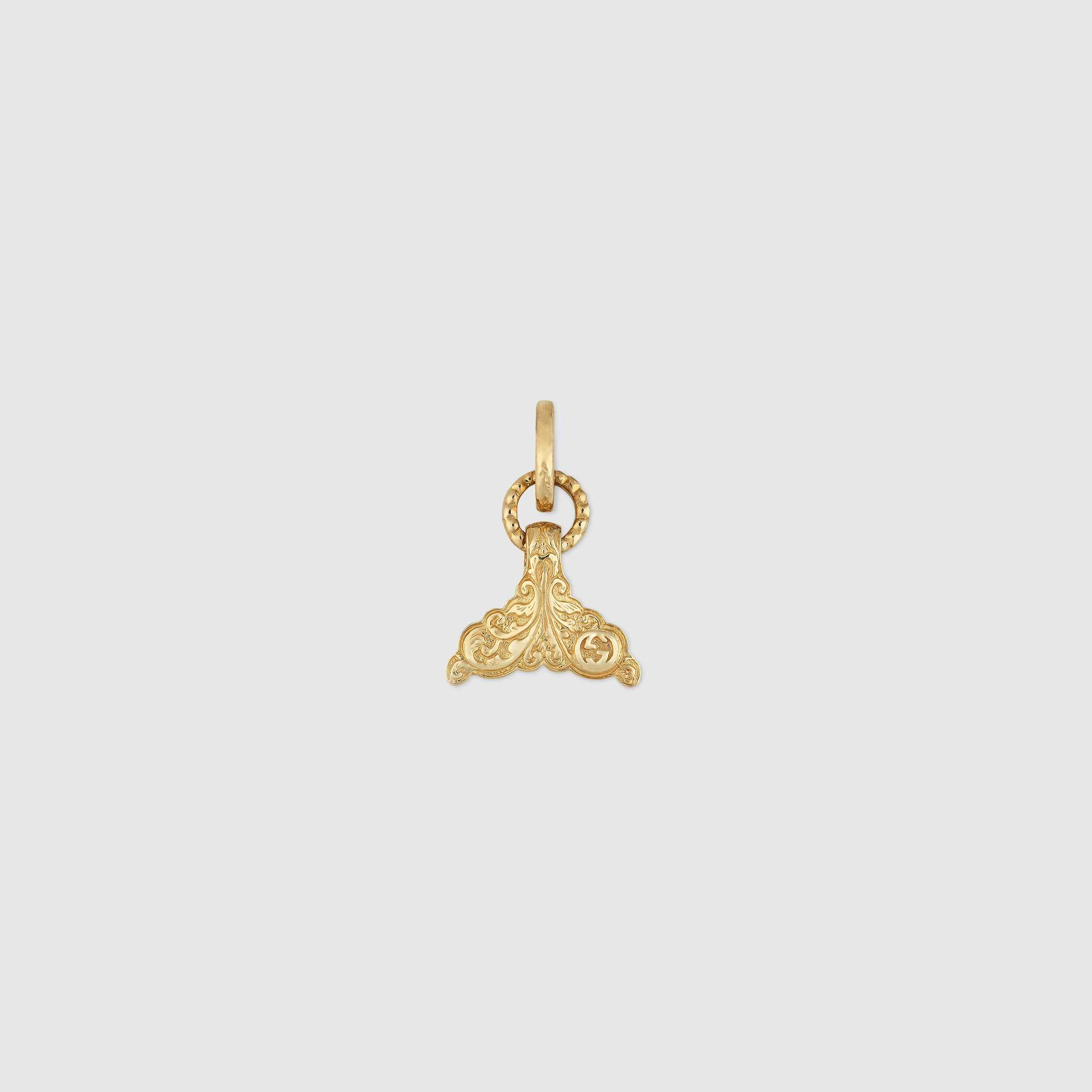 18b1d370ca Shop the Tail fin charm in yellow gold by Gucci. A fin-shaped charm ...