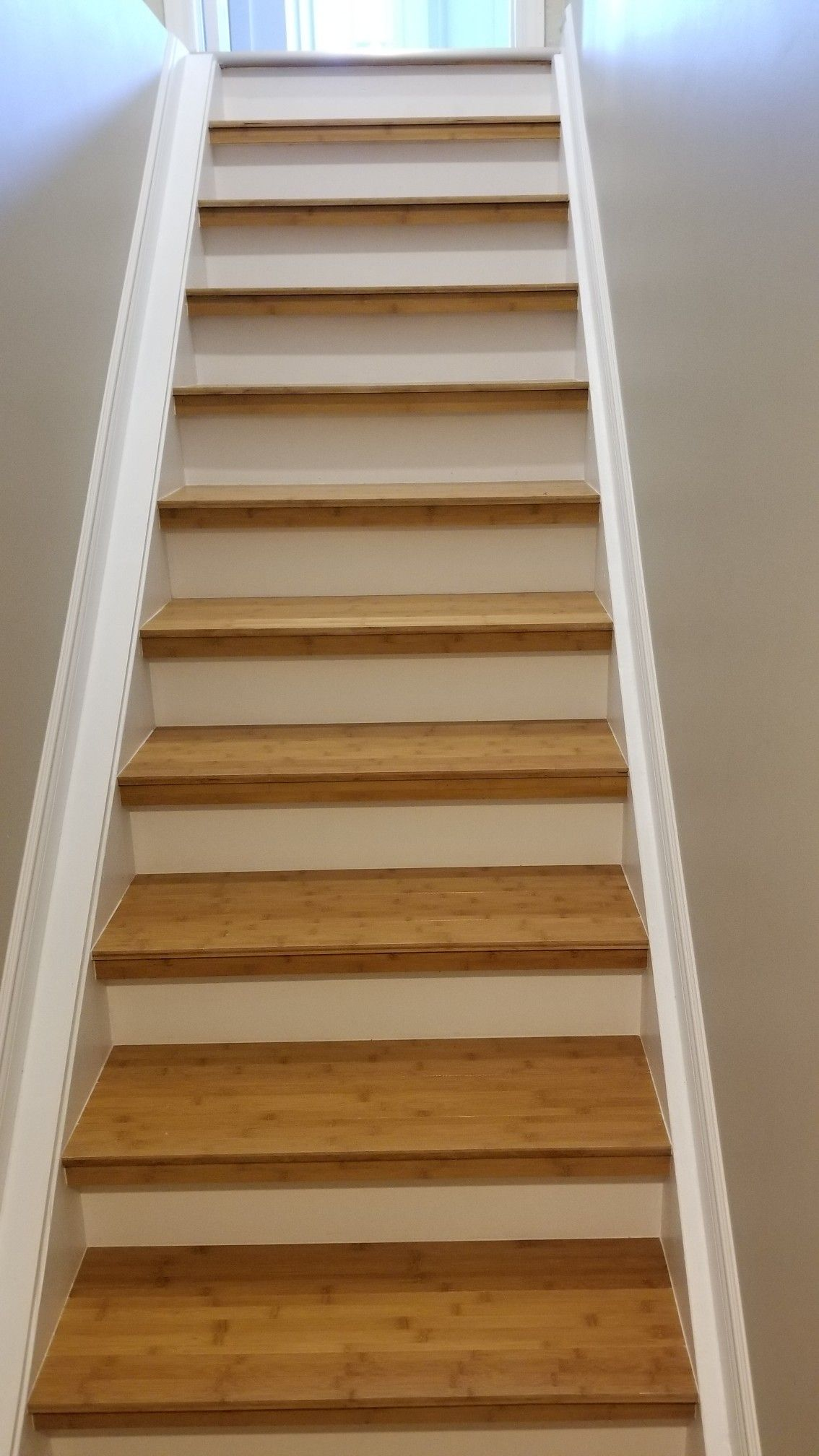 Basement Stairs Dressed Up With Bamboo Hardwood Flooring White