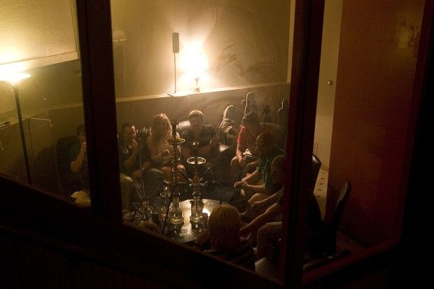 Customers smoke hookah in a lounge area at Sahara Nights on St. Joseph Street. The Rapid City Council tabled discussion on new regulations for hookah lounges at their December 3rd meeting.
