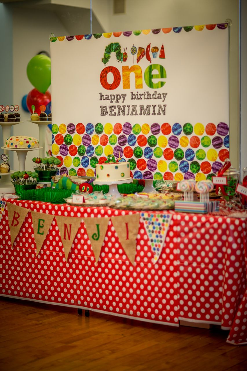 We designed an adorable dessert table for a 1st Birthday Party with a Very Hungry Caterpillar theme (Eric Carle). Great, and easy theme. Bright, primary colors. (Photo courtesy of Smile Bella Photo in NYC). Event at Playgarden NYC
