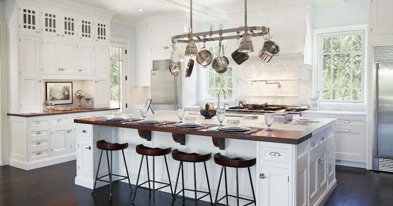 Superb Gorgeous Kitchen With Stainless Steel Hanging Pot Rack, Glossy White Wood  Beams, Windows Flanking Cooktop, White Kitchen Cabinets With Marble  Countertops, .