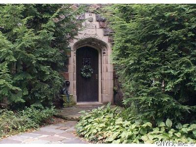 amazing green spaces in this B-Ville home you would think you were on a lavish European estate
