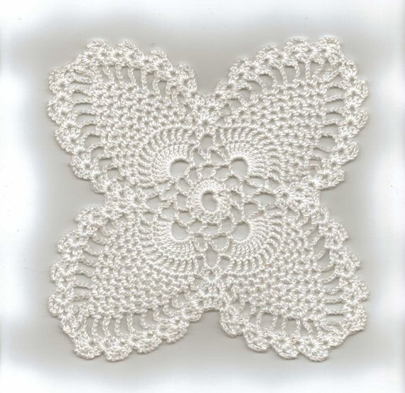 Four Point Pineapple Crochet Doily, Moms favorite pattern was the pineapple. This one was the base to many larger doilies such as runners for the dinning room table. Just make a number of squares and fasten them together in what ever size you want.