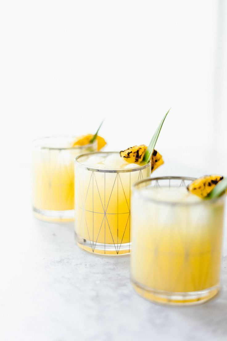 Spiked Grilled Pineapple Lemonade #pineapplelemonade The cocktail that will be on repeat all summer long- Spiked Grilled Pineapple Lemonade! sweetened with Maple Syrup and a splash of Malibu Rum. #summercocktails #cocktailrecipes #pineapplecocktails #lemonade #drinkphotography #pineapplelemonade