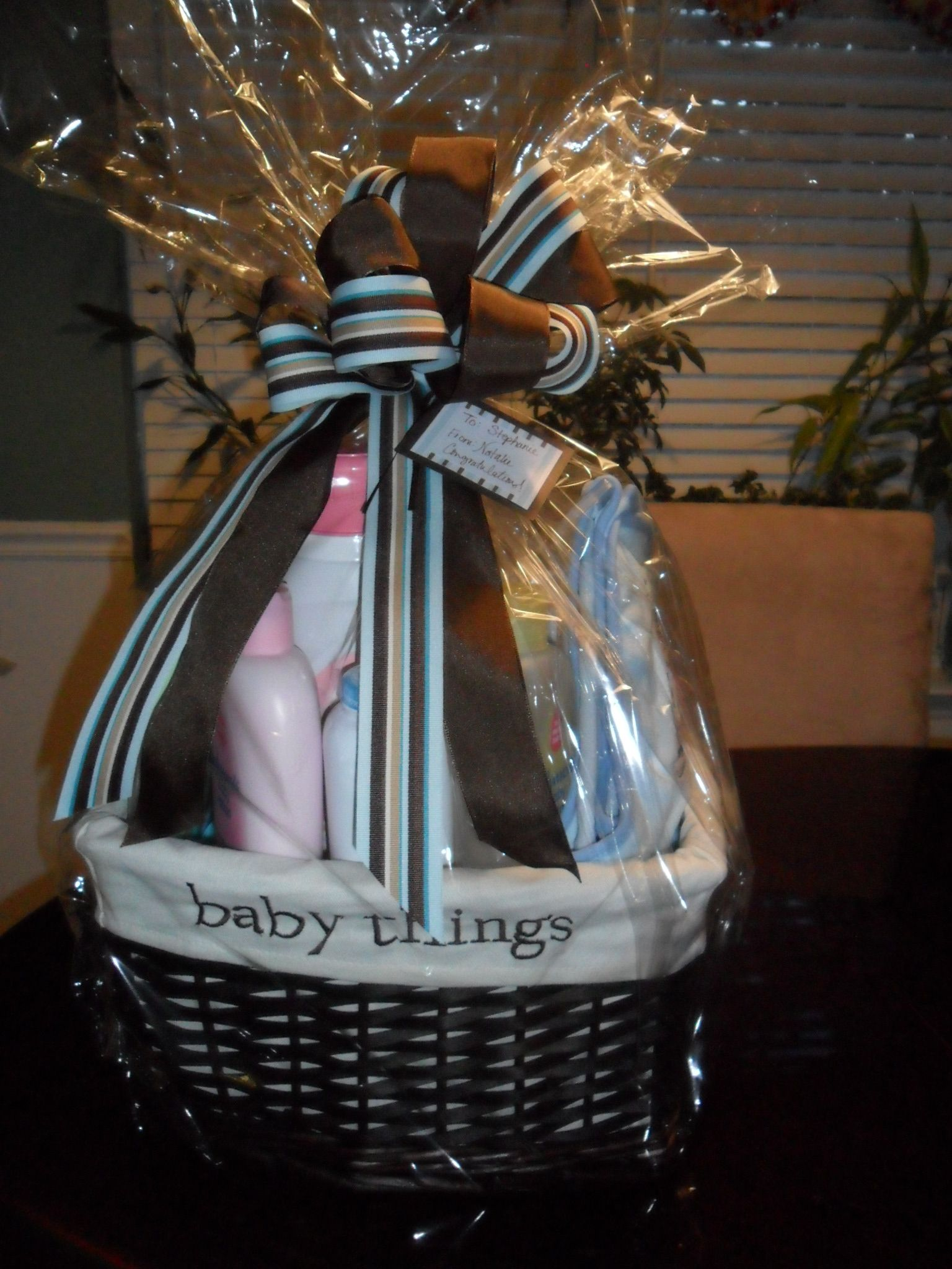 Shower gift basket to coordinate with shower invites
