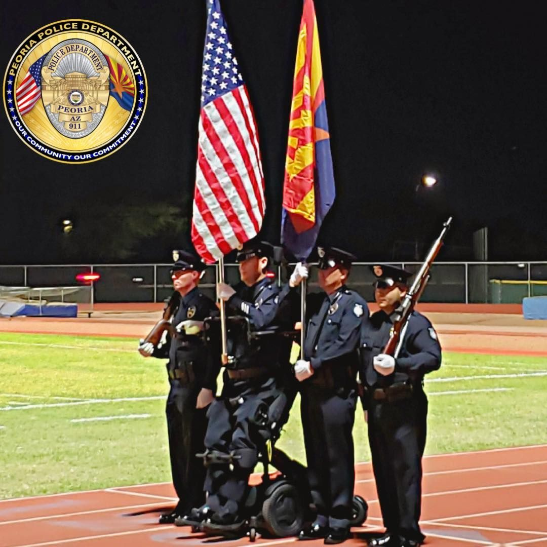 Paralyzed police officer stands for National Anthem in