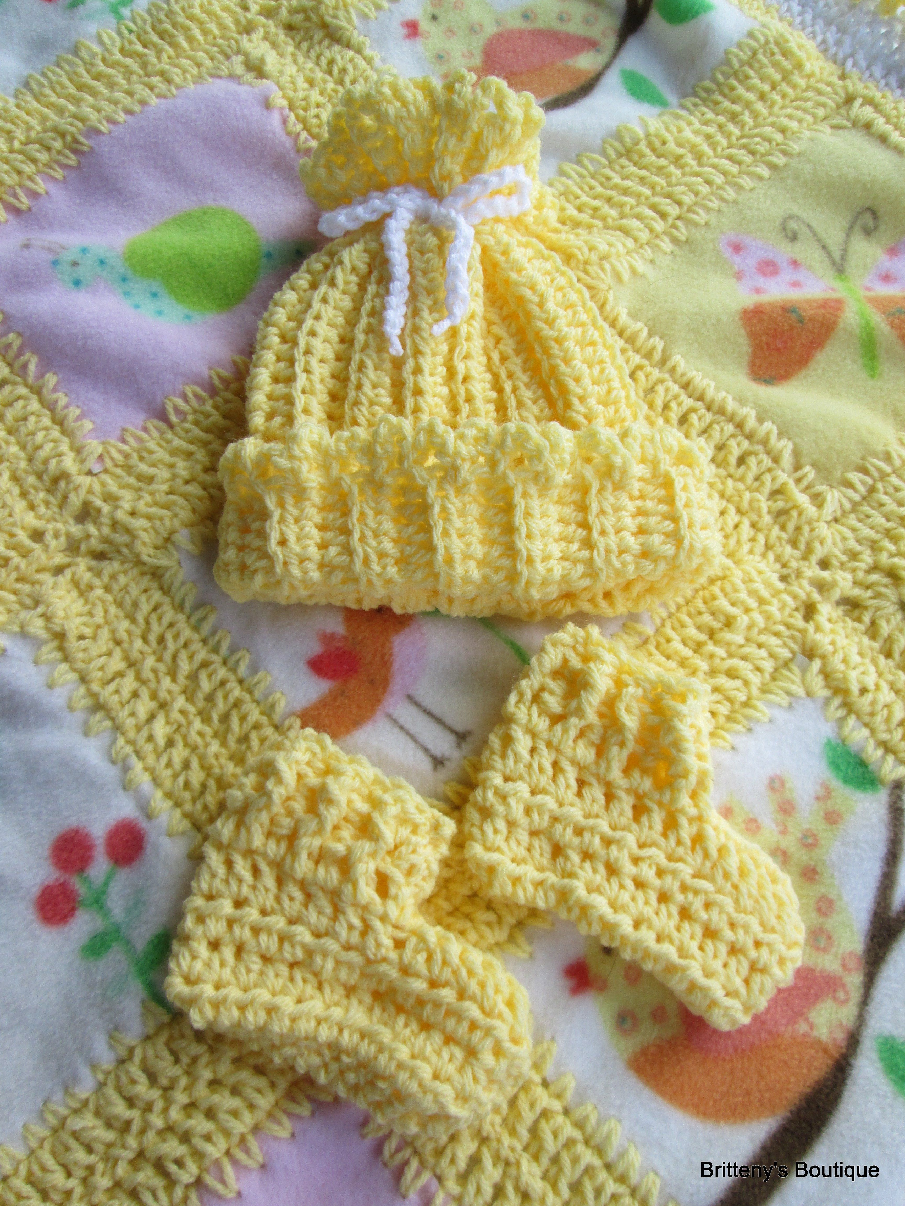 This is a crochet and fleece blanket hat and booties layette set