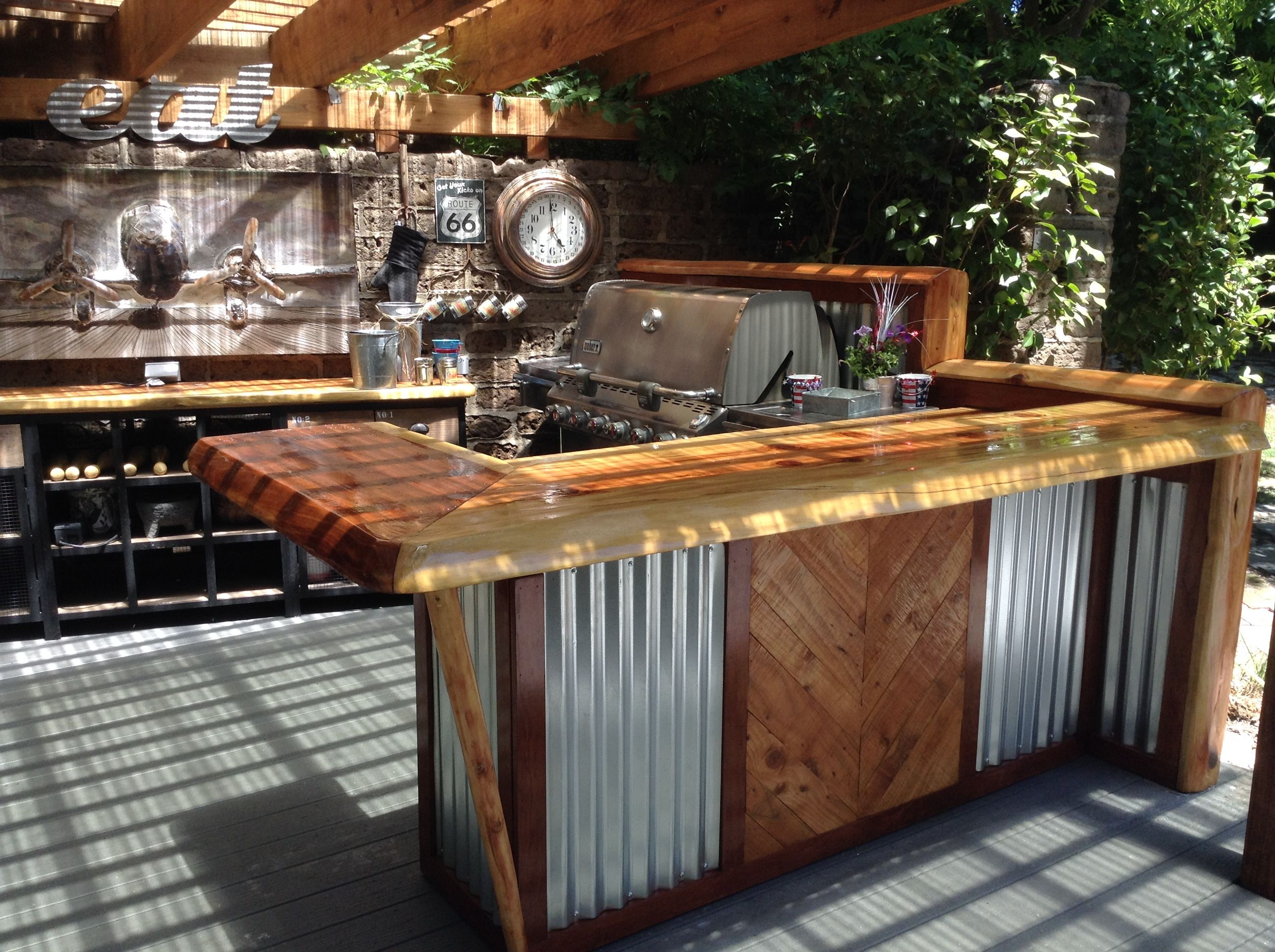 rustic outdoor kitchen red clock and bar ideas