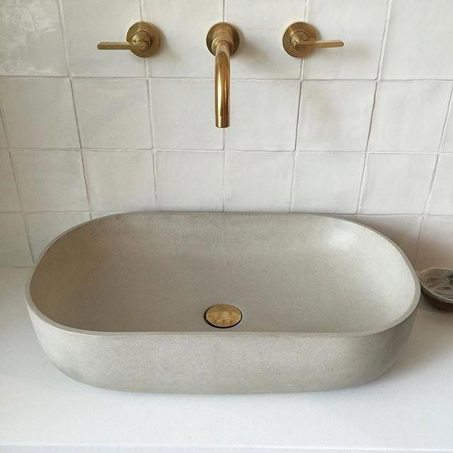 The taps the taps If you dont want a black bathroom you can have a white one with a cast concrete basin from bertandmay