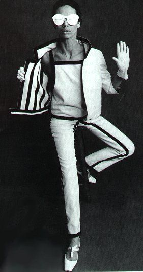 black and white cropped jacket and pants.