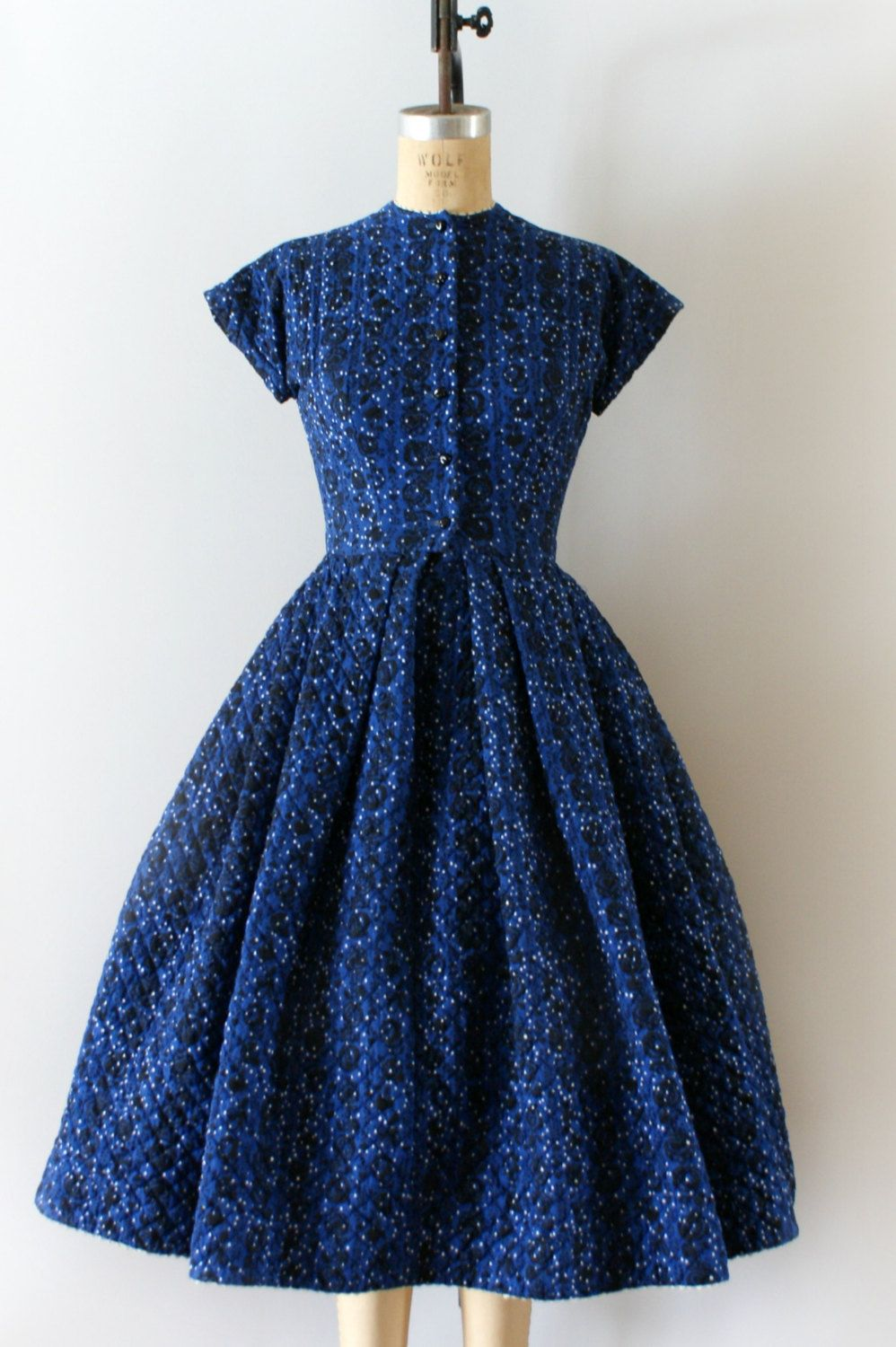 Vintage 1950s Lanz dress, blue floral quilted cotton body, fit and flare design features a fitted bodice, button front design, short capped sleeves