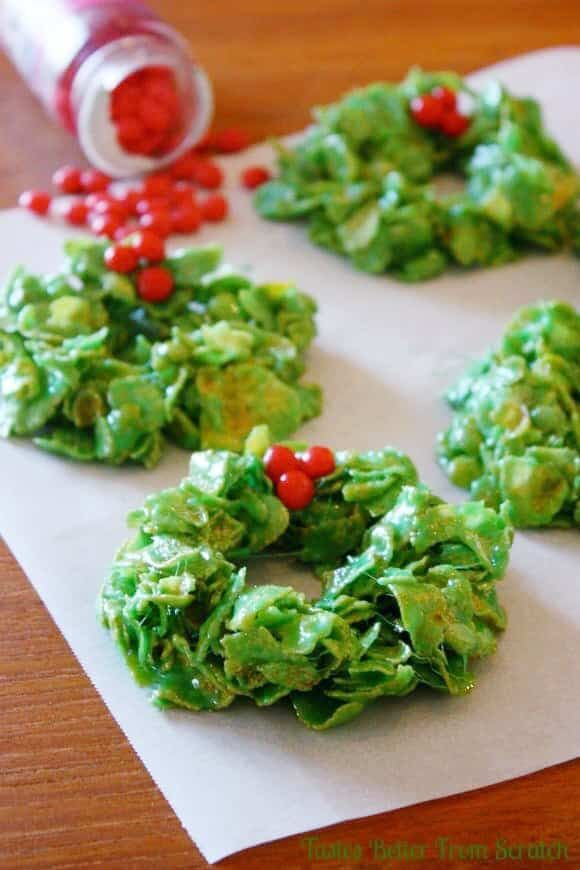 How adorable are these Christmas cornflake wreaths?! The marshmallow and cornflake treats are so good, they're perfect for Christmas parties and such a fun treat to make as a family! #cornflakewreaths #christmastreats #christmas #desserts #recipes #dessertrecipes #treats #holidays #wreath #christmasfood #partyfood #partyideas #easyrecipes