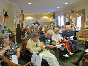 Residents At Sunrise Senior Living On Emmons Avenue Listen To