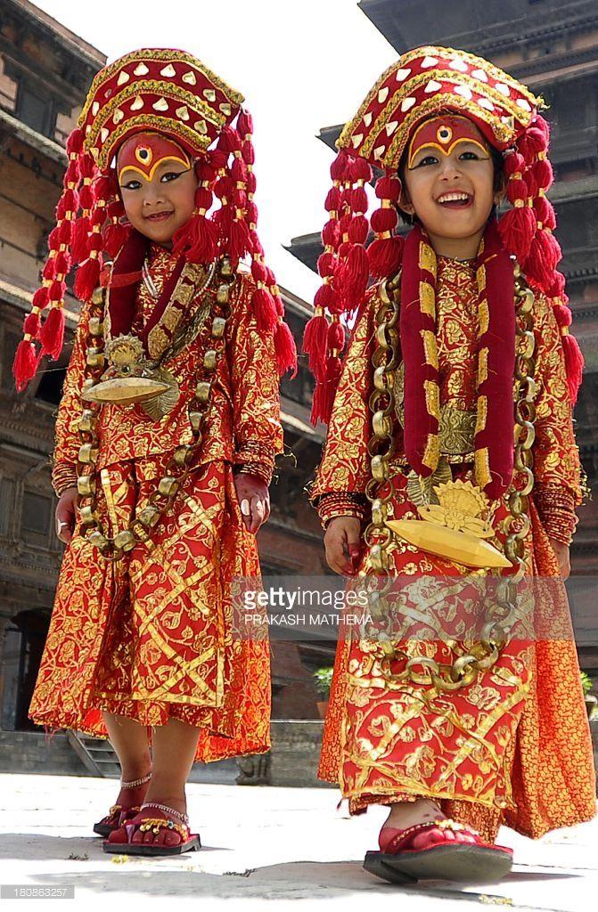f4b6e3191 Young Nepalese girls dressed in the outfit of a Kumari, the living goddess,  pose during Kumari Puja rituals at Hanuman Dhoka in Durbar Square of  Kathmandu ...
