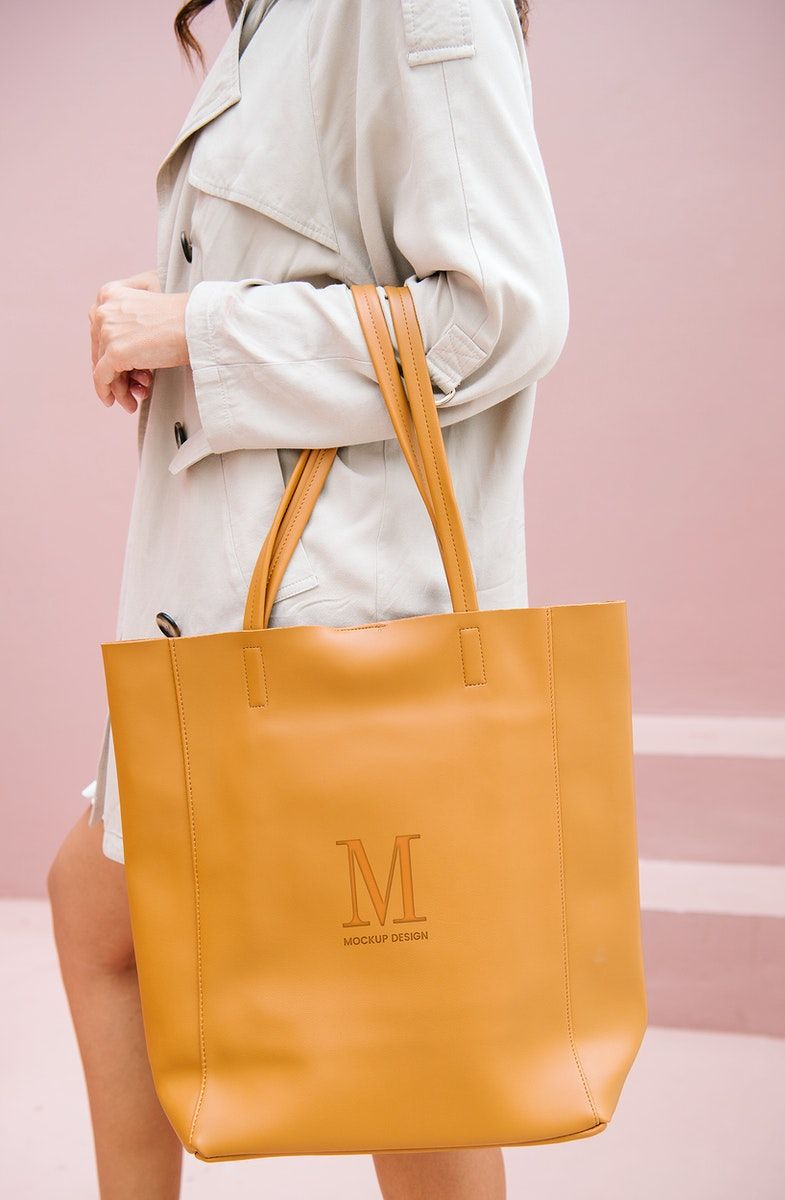 Download Download Premium Psd Of Woman Carrying A Brown Handbag Mockup 1215152 Brown Handbag Tan Leather Bag Handbag