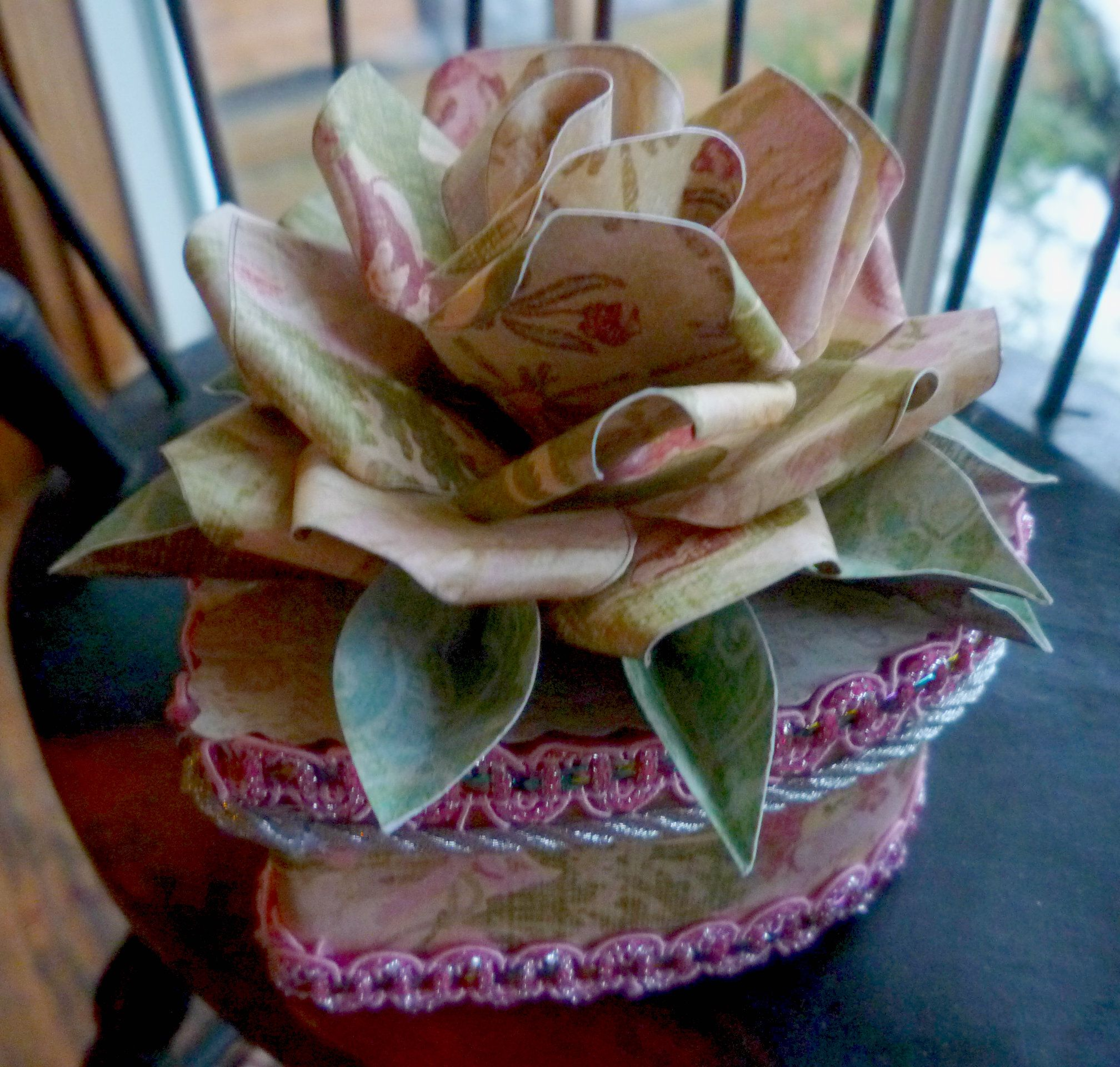 I just learned a new method for making paper roses.  This will keep me busy!