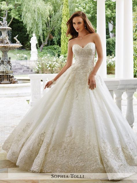 Sophia Tolli - Strapless metallic lace over misty tulle ball gown with sweetheart neckline, rich lace appliqués adorn bodice and hem, back corset, softly gathered voluminous skirt with chapel train. R