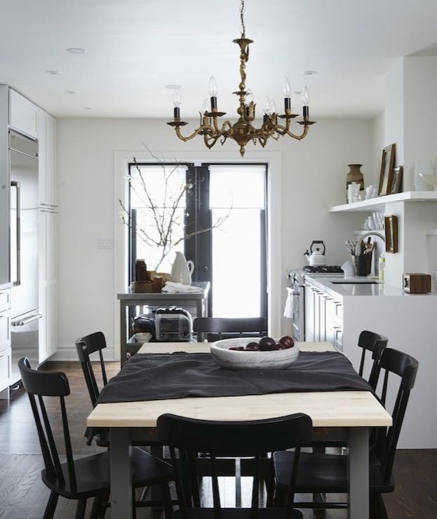 Gorgeous Eclectic Dining Room With Metal Table Oak Top Glossy Black Salt