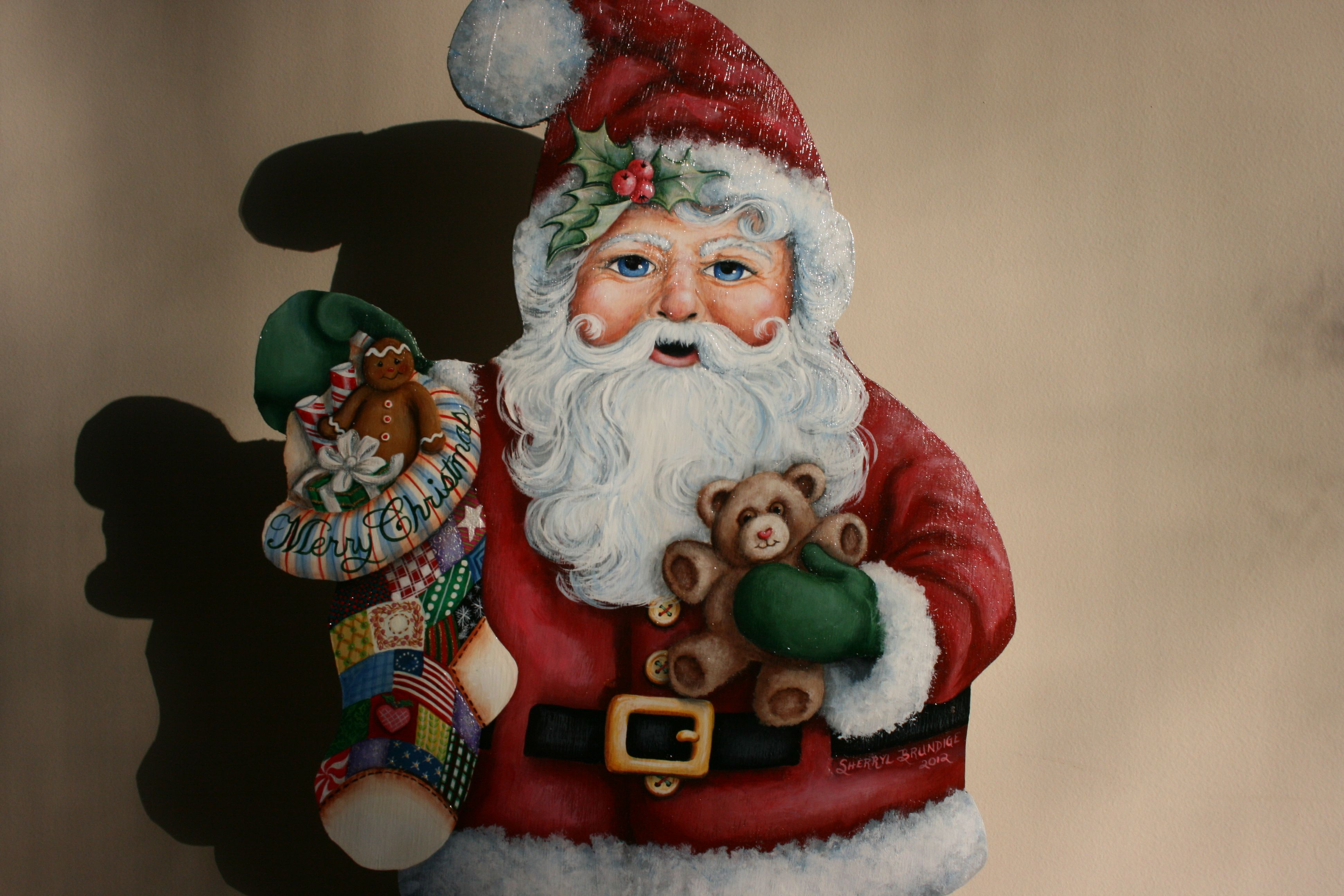 Hand painted Santa Claus with a teddy bear and Christmas stocking on wood by sherrylpaintz.
