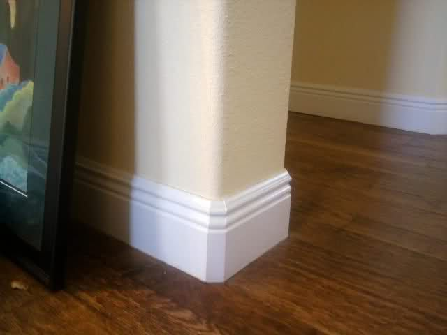 base moulding for curved corners | Here's what a baseboard looks like in our house. Ignore the other junk ...