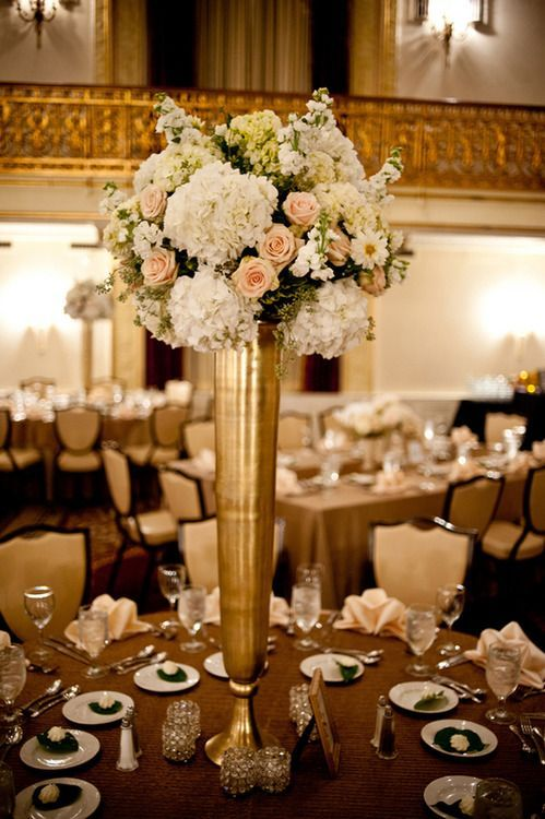 Hydrangeas And Roses In Ivory Blush Pink Displayed A Tall Gold Vase