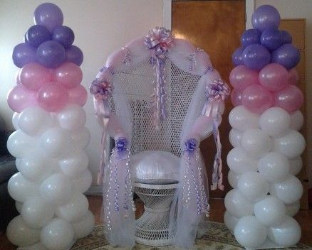 Decorating A Peacock Wicker Chair Of A Bridal Shower Balloon