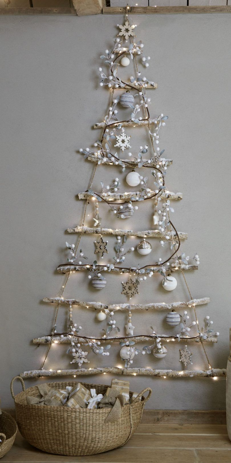 We're totally hung up on this new alternative Christmas tree trend. If your home is short on space during the festive season, then this Christmas tree could be just the way to go. It's a Christmas tree, but not as we know it... #christmastreetrends #modernchristmasdecorating #christmastrends2018 #christmasdecorations