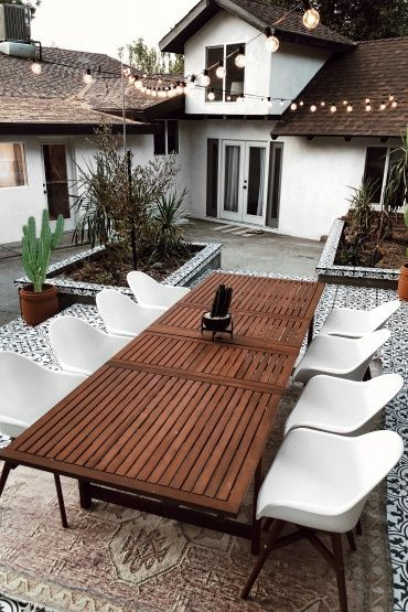backyard remodel with tile patio and large table for outdoor entertaining #patio #backyard #backyardremodel