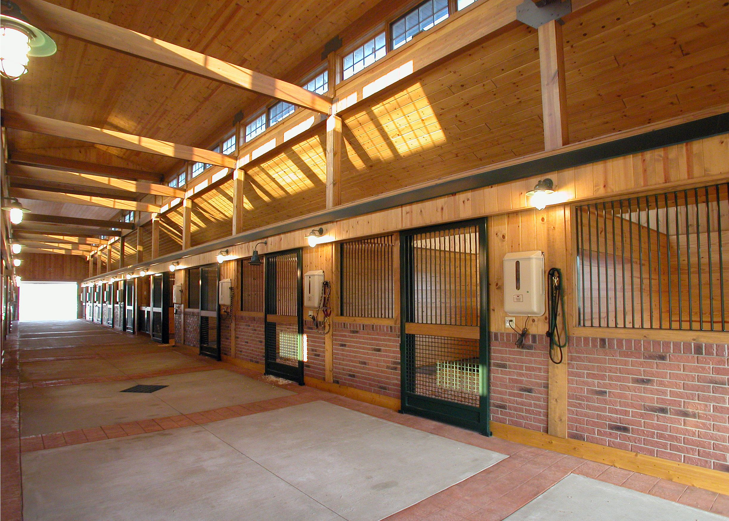 Horse Stables And Barns : Aisle view in a horse barn designed by gh gralla equine