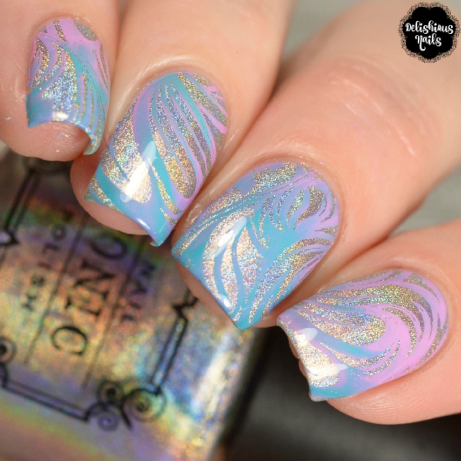 Holographic nails with whimsical nail stamping art design