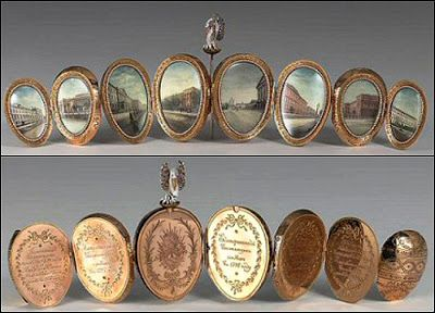 The Dowager Egg (or Imperial Pelican Egg) - Fabergé, xxxx; made for the centennial celebration of the patronage of charitable institutions by the Dowager Empress of Russia;  when taken off the stand the whole egg opens up and unfolds into eight oval panels, each rimmed in pearls.
