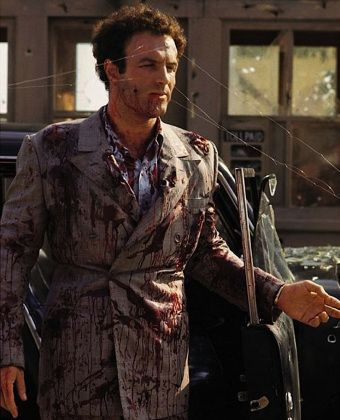 """James Caan being fitted for his death suit as """"Sonny"""" Corleone in The Godfather."""