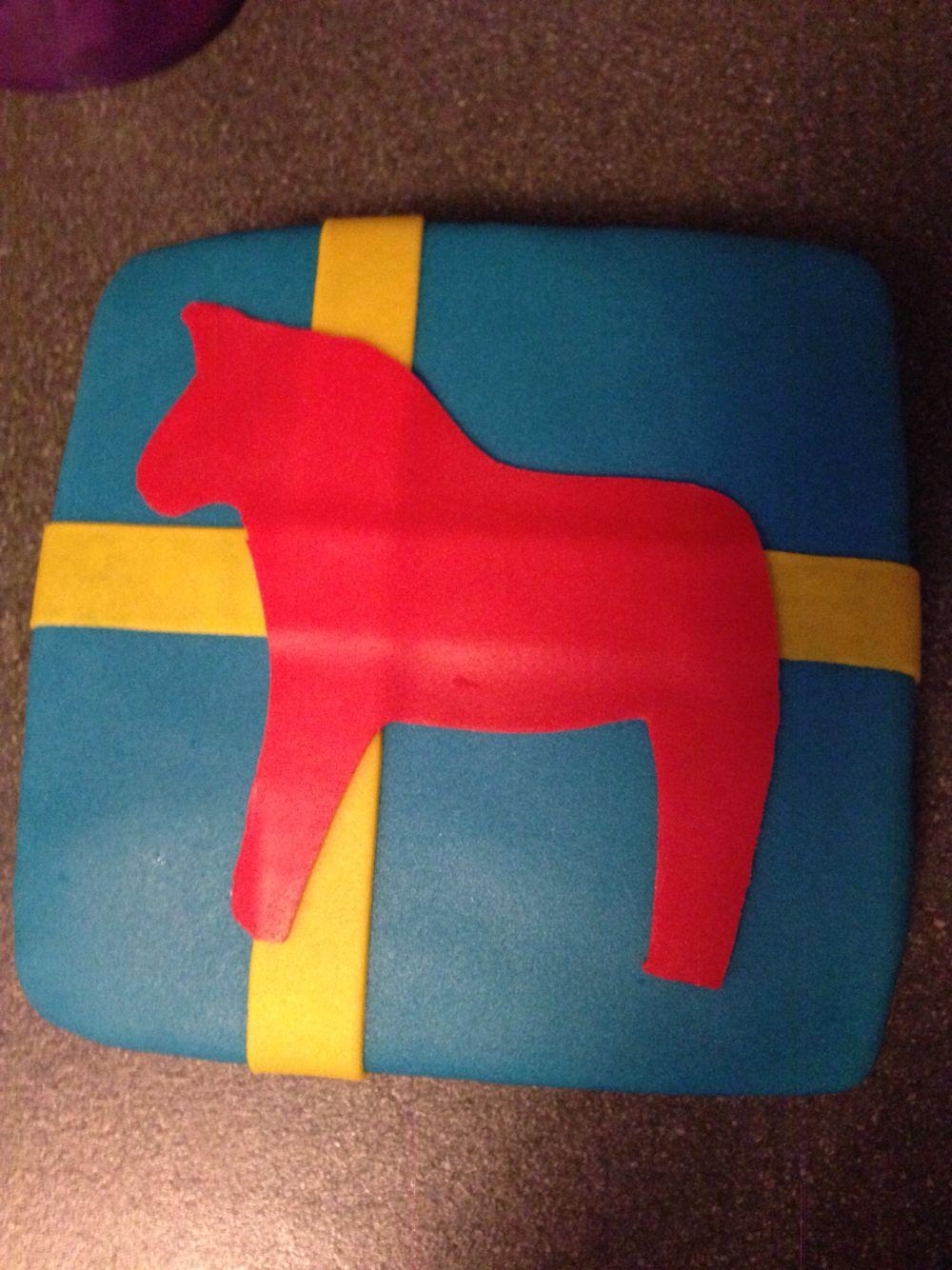Zweedse vlag met Dalarna paardje
