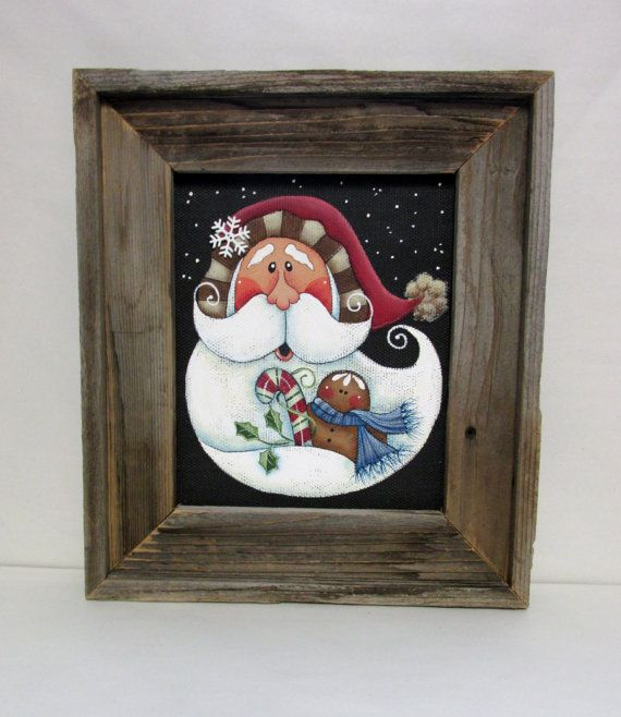 Folk Art Santa with Gingerbread Man and Candy Cane, Tole or Hand Painted, Framed in Rustic Reclaimed Barn Wood, Christmas Santa, Framed Art  This fun Santa with a gingerbread man and candy cane is a tole painting pattern by Renee Mullins. I have adjusted this to fit in this size frame. This scene has been hand painted with acrylic paints onto black fiberglass solar screen. The frame is hand made of reclaimed rustic barn wood with a raised lip on the edge making it a dimensional 1 ¼ inch…