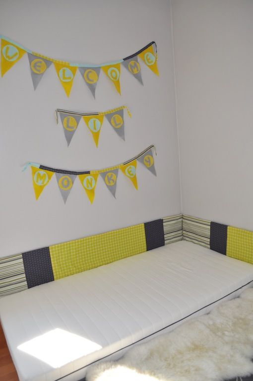 """montessori style floor bed for baby - love the """"bumper"""" that was sewn together in coordinating colors!"""