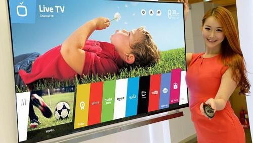 A model showing off a LG Smart TV with webOS platform. -- PHOTO: LG.