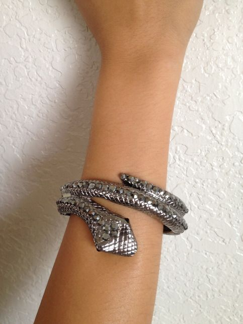 Dark gray clasp snake bracelet with rhinestones -------------------------- would be super cute with a dark green jacket