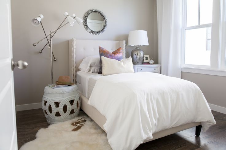 Chic Girl S Bedroom Features A Black Sunburst Mirror Over A Twin
