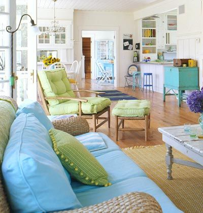 A Living Room With Brightly Colored Furniture  Interior Impressive Living Room Beach Decorating Ideas Decorating Design