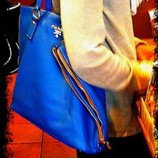 1924c7e9f0ae ... spain new york city is like an ocean blue prada slim tote with golden  side 94a33