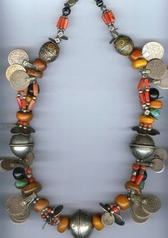 """Necklace having coral, amber, amazonite and enameled """"egg beads"""" and coins. Tiznit, Morocco © Linda Pastorino"""