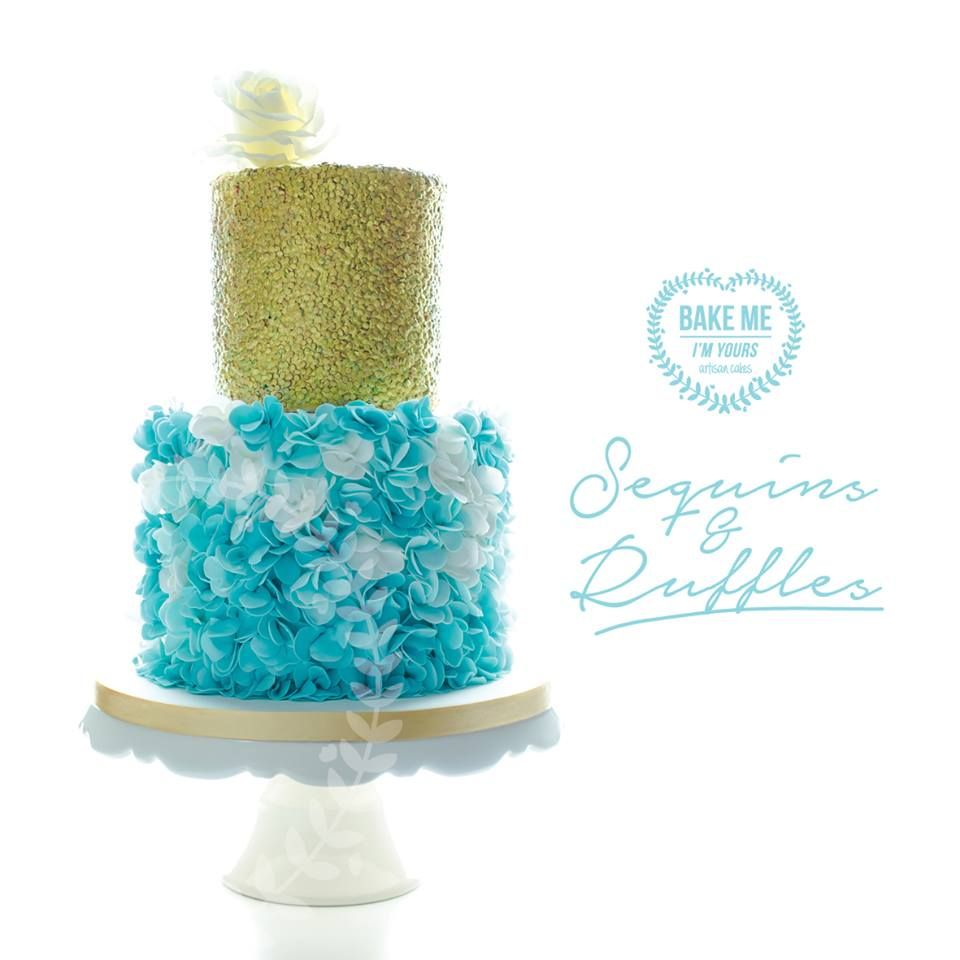 A fancy 40th cake of gold sequins and blossom ruffles in varying shades of turquoise and fresh splashes of white.