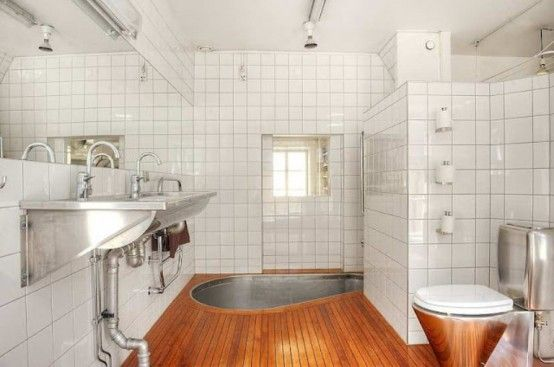 Bath at floor level with shower Apartment interior