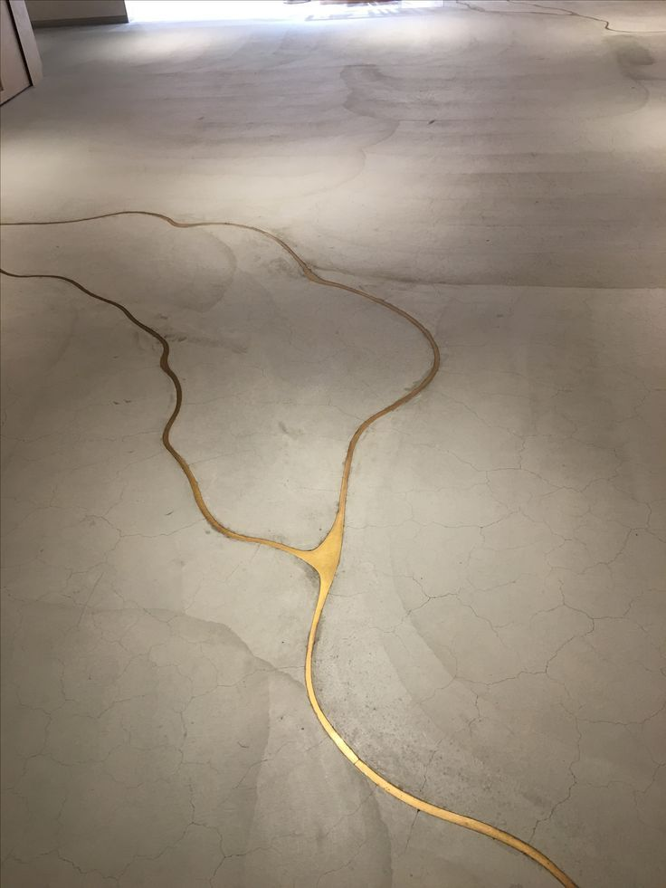 If Our Concrete Floor Cracks We Re Doing This To It It S Concrete With Liquid Gold To Fill The Cracks Kintsugi Concrete Floors Floor Design