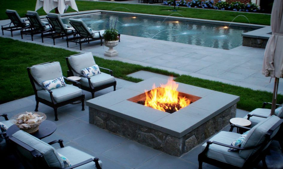 Furniture Rectangular Outdoor Gas Fireplace Around Black Steel Furniture Chairs White Cushions Above Granite Floor Beside Swimming Pool With Relax Chairs Modern