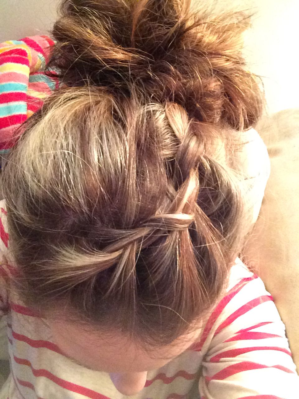 I decided to put blonde highlights back in my hair and put it into a messy bun with a front braid. It's my favorite color and style I've ever had my hair so far for casual, every day wear.