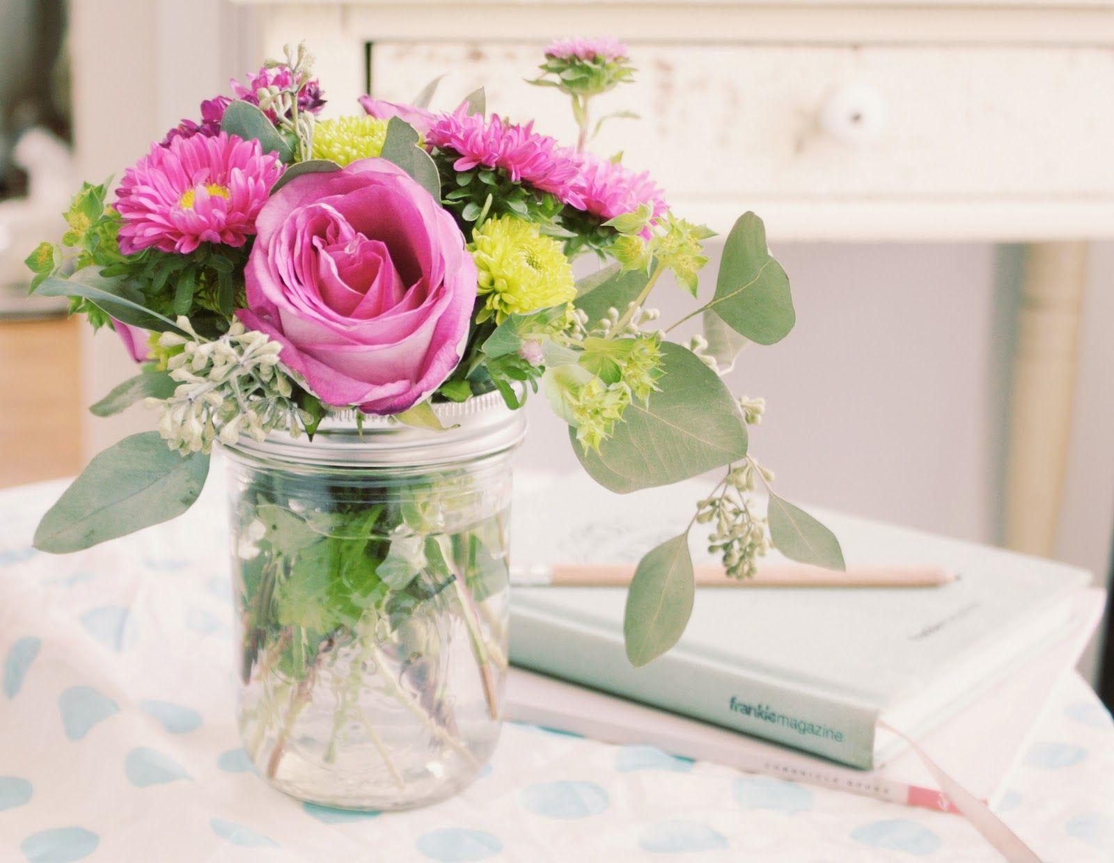 Wedding flower arangements using mason jars flowers from for How to arrange flowers in mason jar