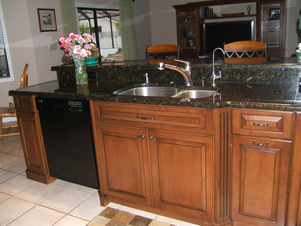 Best color with cherry cabinets quartz or granite for Kitchen colors cherry cabinets