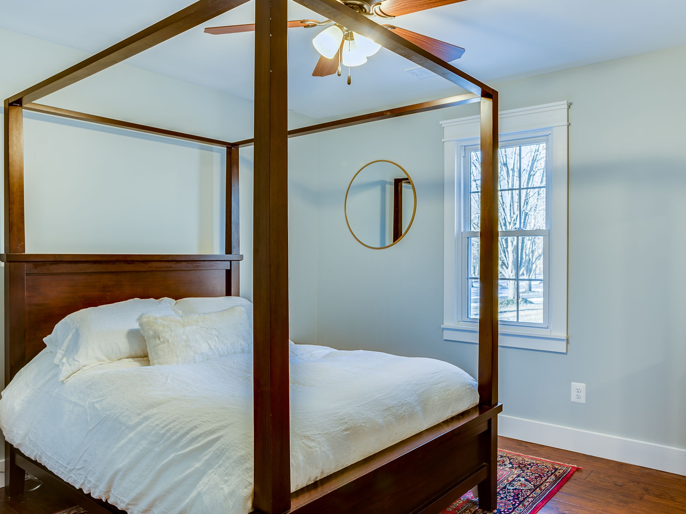 Modern farmhouse guest bedroom with a canopy bed from